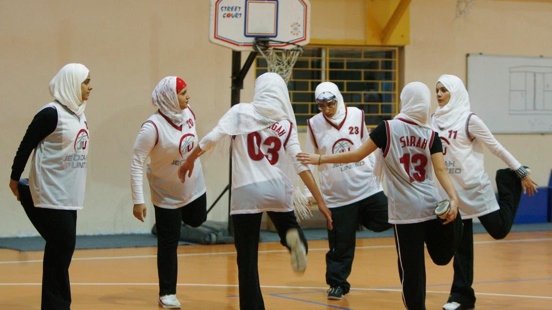 Saudi Arabia's Jeddah United warm up before their friendly basketball game against Jordan's Al Reyadeh in Amman April 21, 2009. (Reuters)
