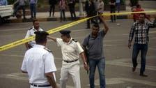 Cairo bomb wounds two policemen, civilian