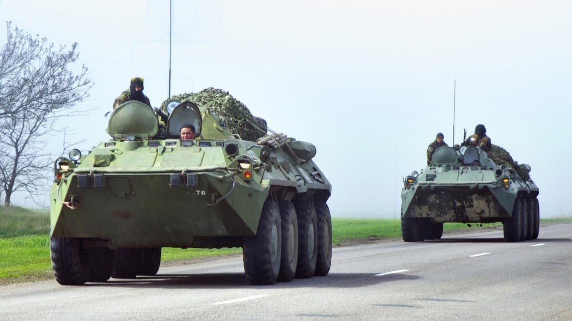 Ukrainian armoured personnel carriers (APC) drive in the Donetsk region on the road from Donetsk to Odessa on April 15, 2014. (AFP)