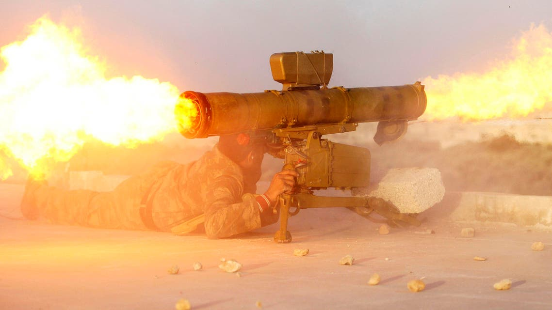 A fighter from the Tawhid Brigade, which operates under the Free Syrian Army, fires an anti-tank missile in Aleppo, November 14, 2013. (Reuters)