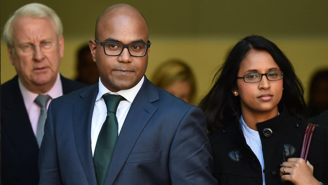 Doctor Dhanuson Dharmasena (C) leaves following a hearing where he faced charges under the Female Genital Mutilation Act at Westminster Magistrates Court in London on April 15, 2014.