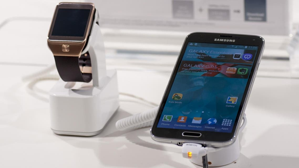 The Samsung Galaxy S5 and Gear 2 smartwatch on display at the Mobile World Congress 2014. (File photo: Shutterstock)