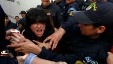 Algeria police violently disperse election protest