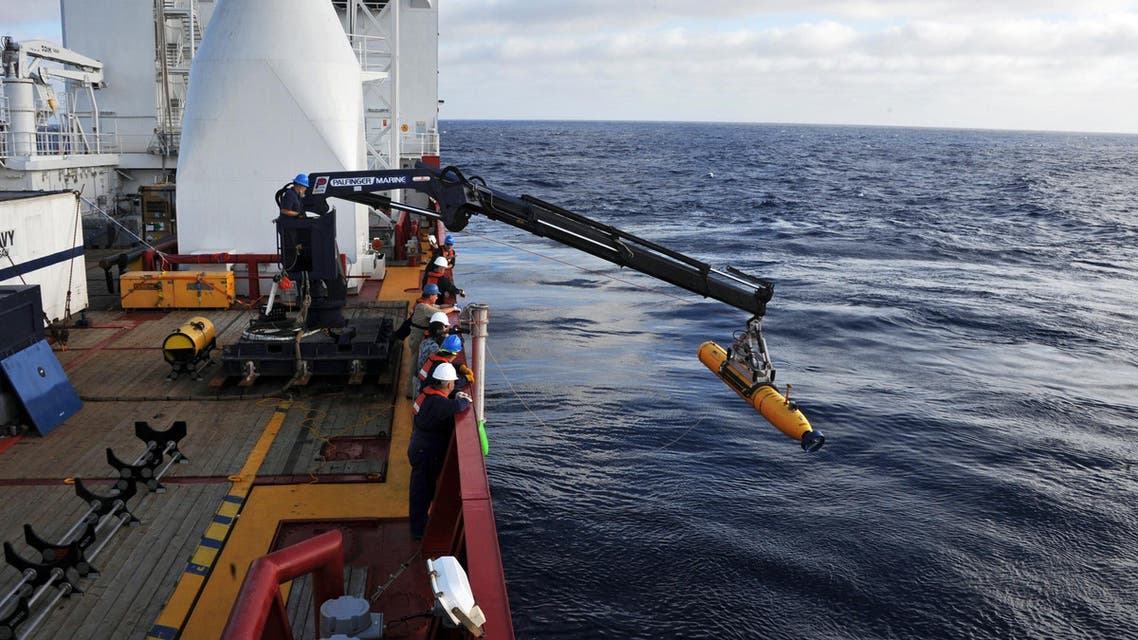 This handout image from the U.S. Navy shows operators aboard ADF Ocean Shield moving U.S. Navy's Bluefin-21 into position for deployment in the search of missing Malaysia Airlines flight MH370. (AFP)