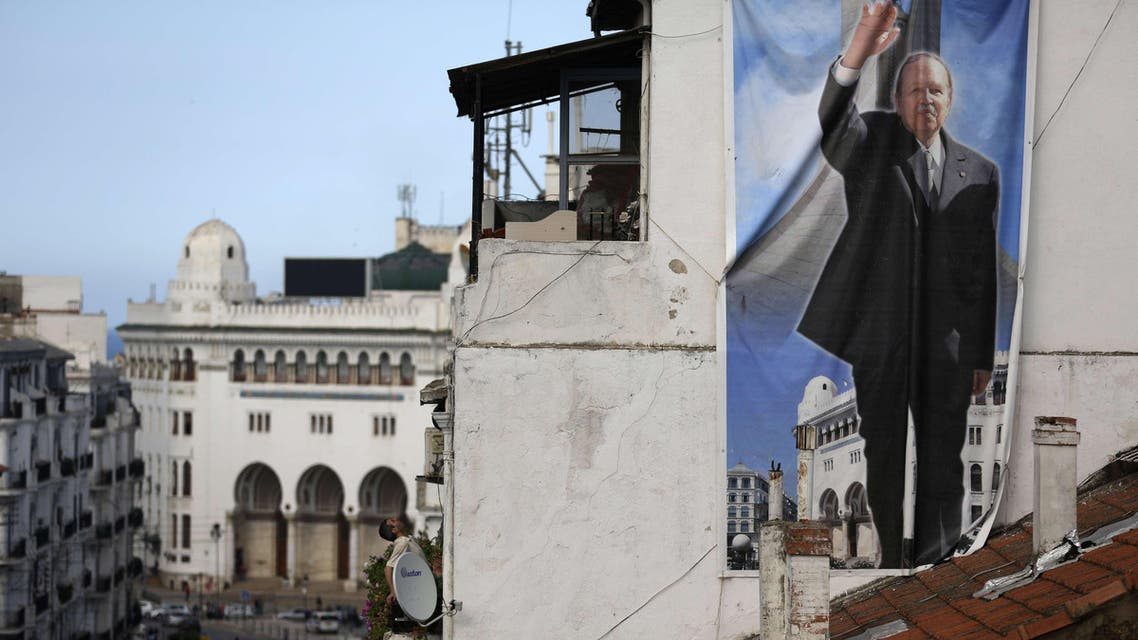 A poster showing Algerian President and candidate to the presidential elections Abdelaziz Bouteflika hangs on a building in the center of the capital Algiers on April 17, 2014. (AFP)