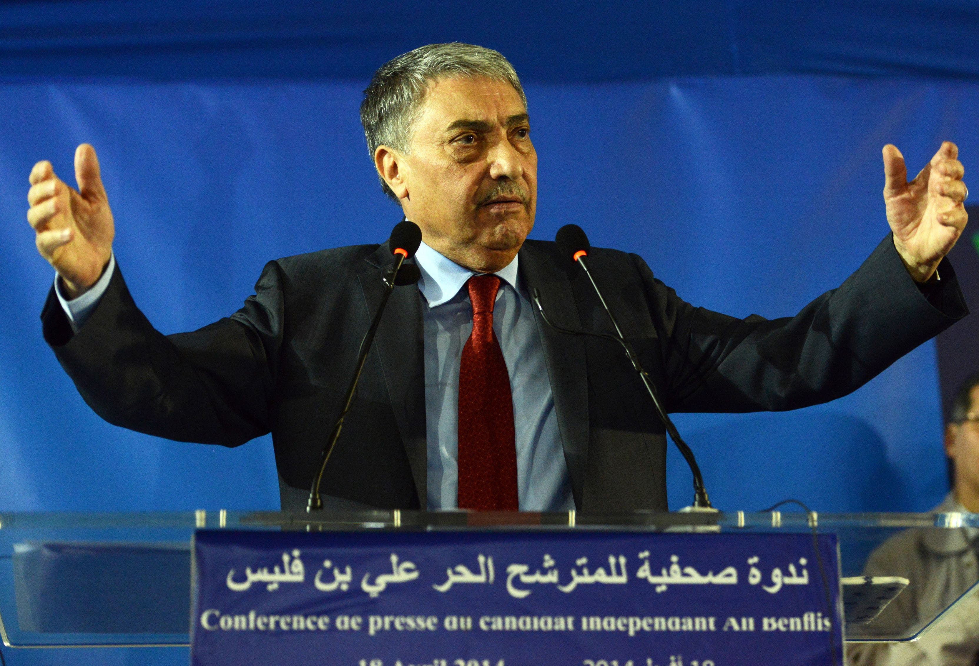 Algerian opposition leader Ali Benflis gestures during a press conference following his defeat in the presidential elections in Algiers on April 18, 2014. (AFP)