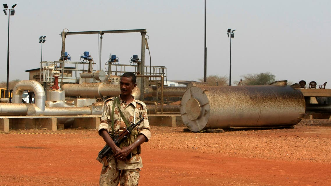 A member of the military stands guard near pump stations at an oilfield in Sudan. (File photo Reuters)