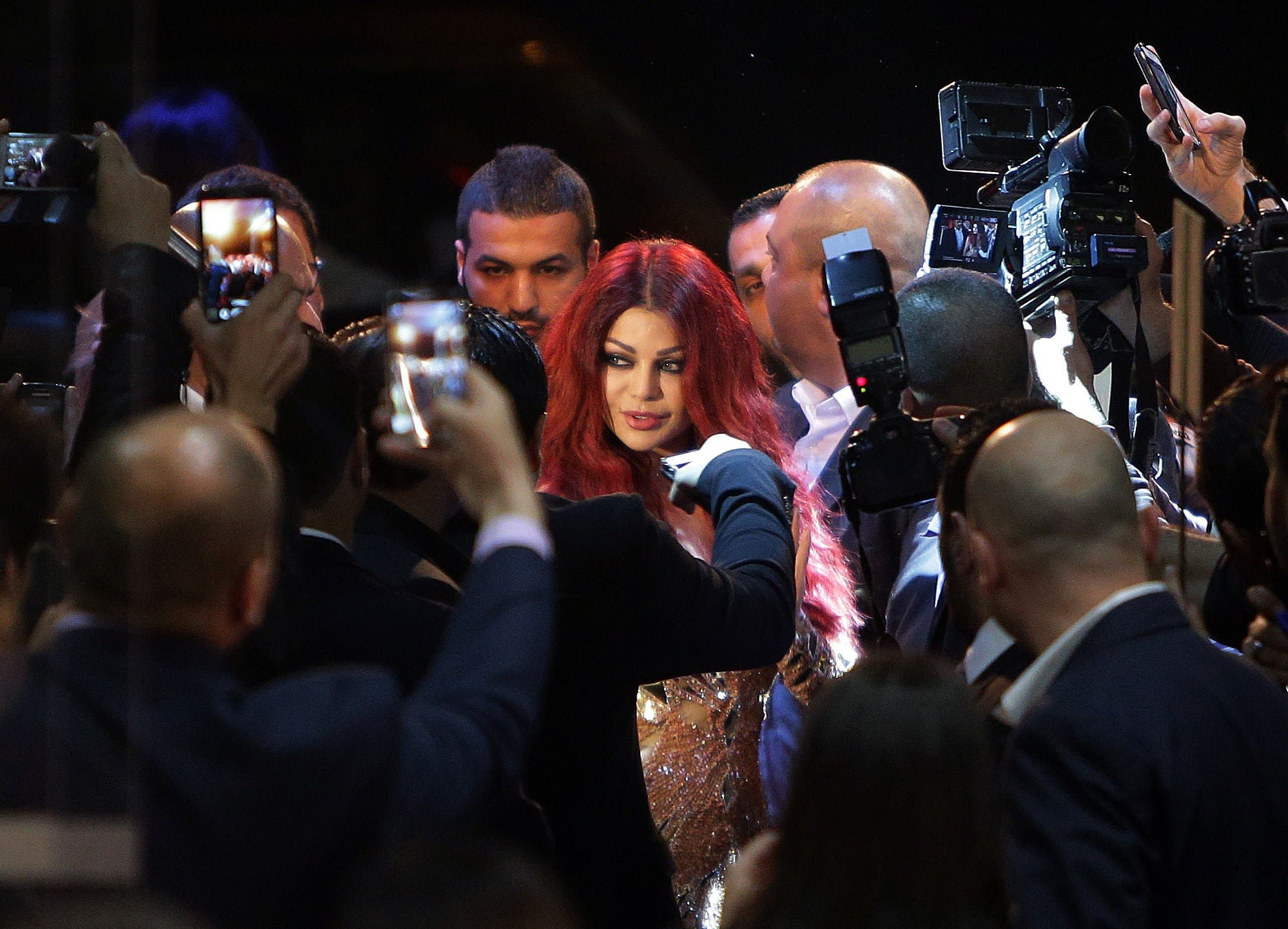 A file picture taken on April 8, 2014 shows Lebanese pop star Haifa Wehbe arriving for the Premiere of her movie 'Halawet Rooh' at a movie theatre in the town of Dbayeh, North of Beirut. AFP