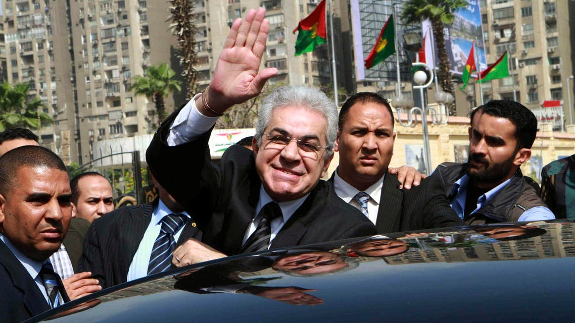 Leftist politician Hamdeen Sabahi (C) waves upon arrival to submit his bid to run as presidential candidate to the presidential election committee in Cairo. (Reuters)