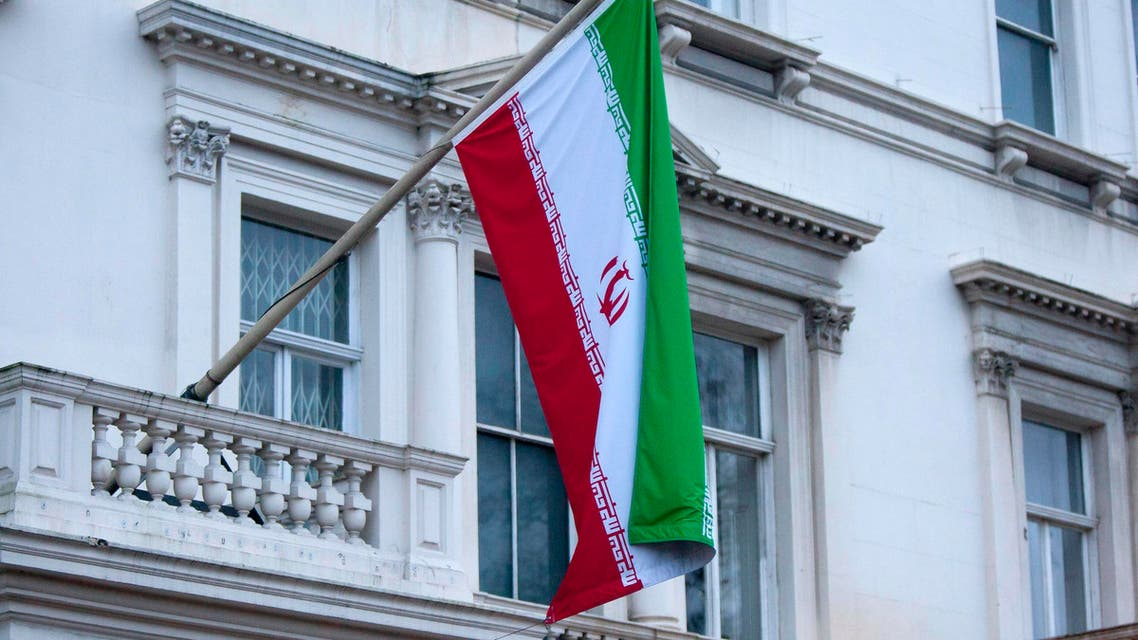 Iran's flag is seen hanging from the Iranian Embassy in central London reuters