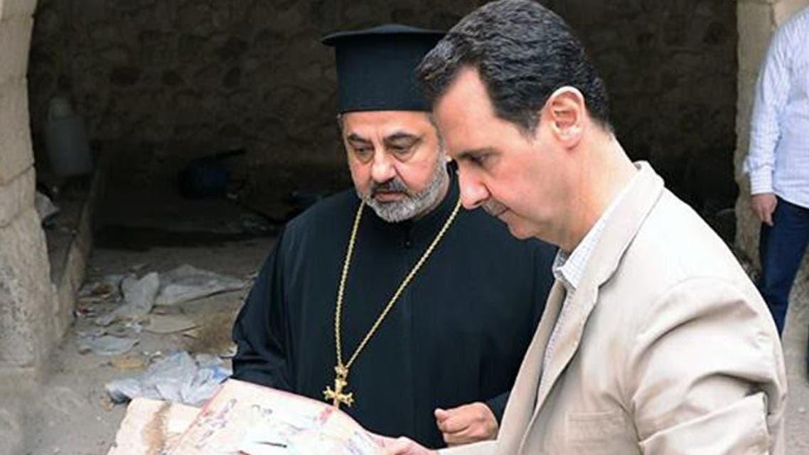 A picture uploaded on the official Facebook page of the Syrian Presidency on April 20, 2014, shows Syria's President Bashar al-Assad looking at icons as he visits a monastery in the ancient Christian town of Maalula which his troops recently recaptured from rebels.