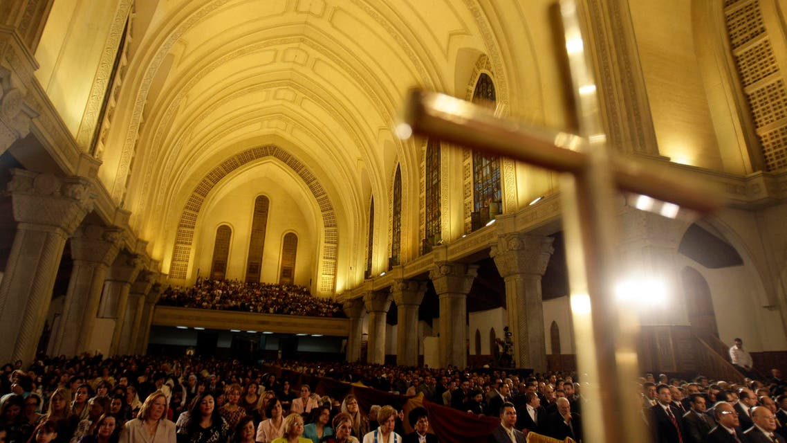 Worshippers attend the Easter midnight mass at the main Coptic Cathedral of Saint Marcos in Cairo. (File photo: Reuters)
