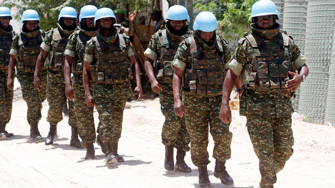 Uganda People Defence Forces (UPDF) soldiers serving in an United Nations (U.N.) guard brigade walk to the U.N. compound upon arrival outside the airport in Somalia's capital Mogadishu, April 17, 2014.