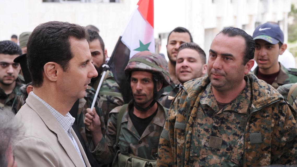 Syrian President Bashar al-Assad (L) talks to soldiers during his visit to Maaloula town, northeast of Damascus April 20, 2014. (Reuters)