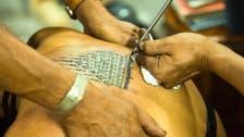 Sri Lanka detains British tourist over Buddha tattoo