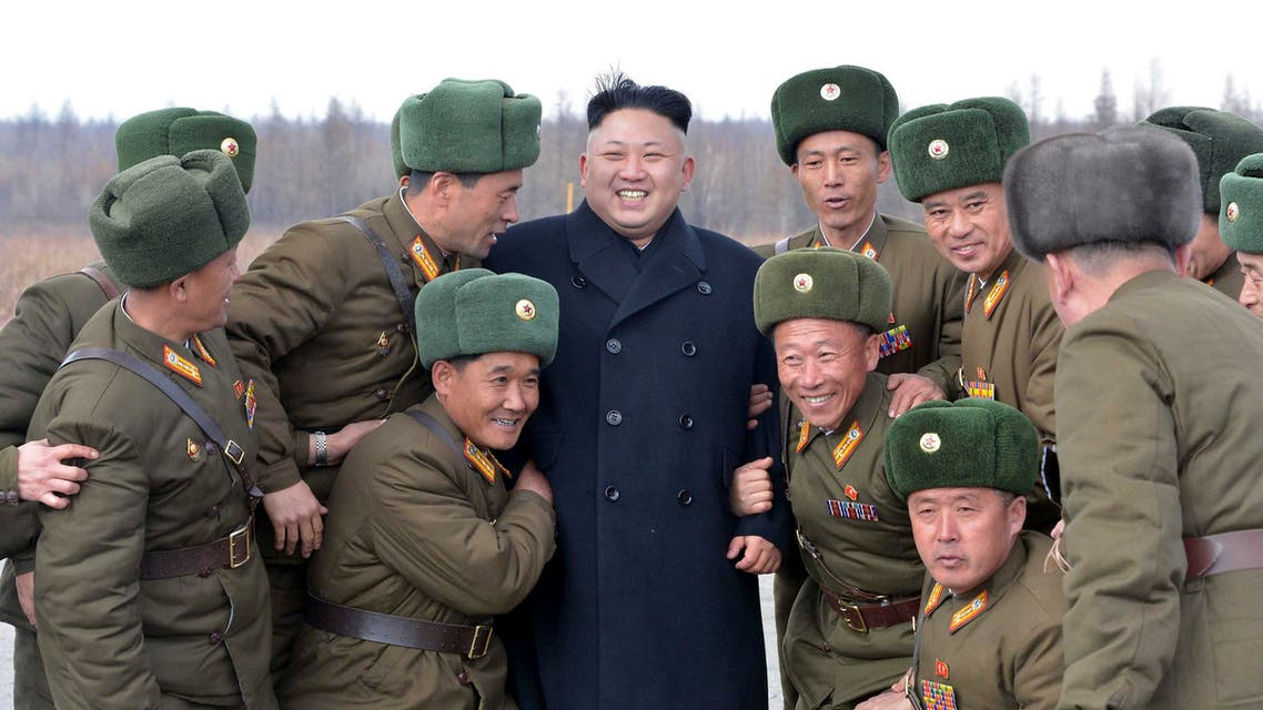 North Korean leader Kim Jong Un (C) smiles as he stands with commanding officers of the combined units of the Korean People's Army reuters