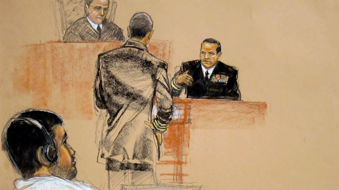 In this sketch approved by the military by court artist Janet Hamlin Abd Al Rahim Muhammad al-Nashiri (L) watches courtroom proceedings. (Reuters)