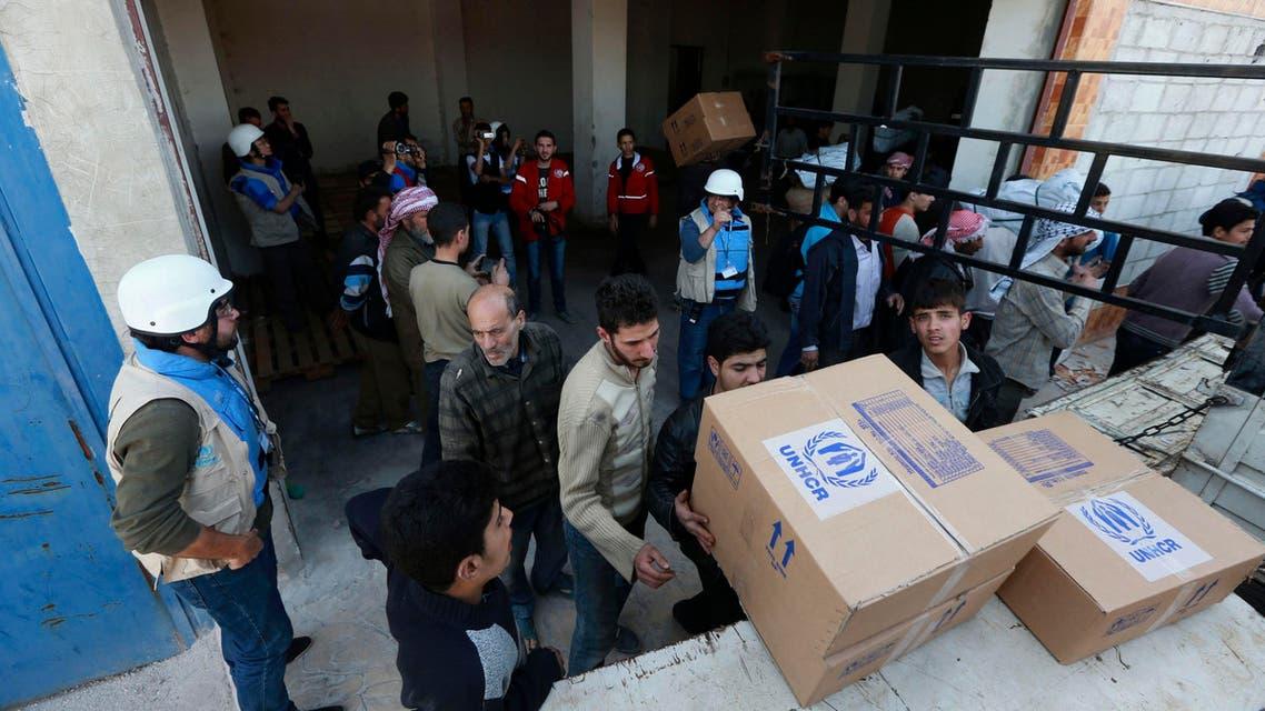 مساعدات انسانية سوريا لاجئين