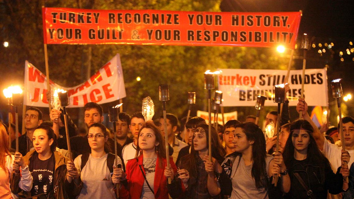 Demonstrators attend a torch-bearing march marking the anniversary of the 1915 mass killings of Armenians in the Ottoman Empire, in Yerevan April 23, 2014. (Reuters)