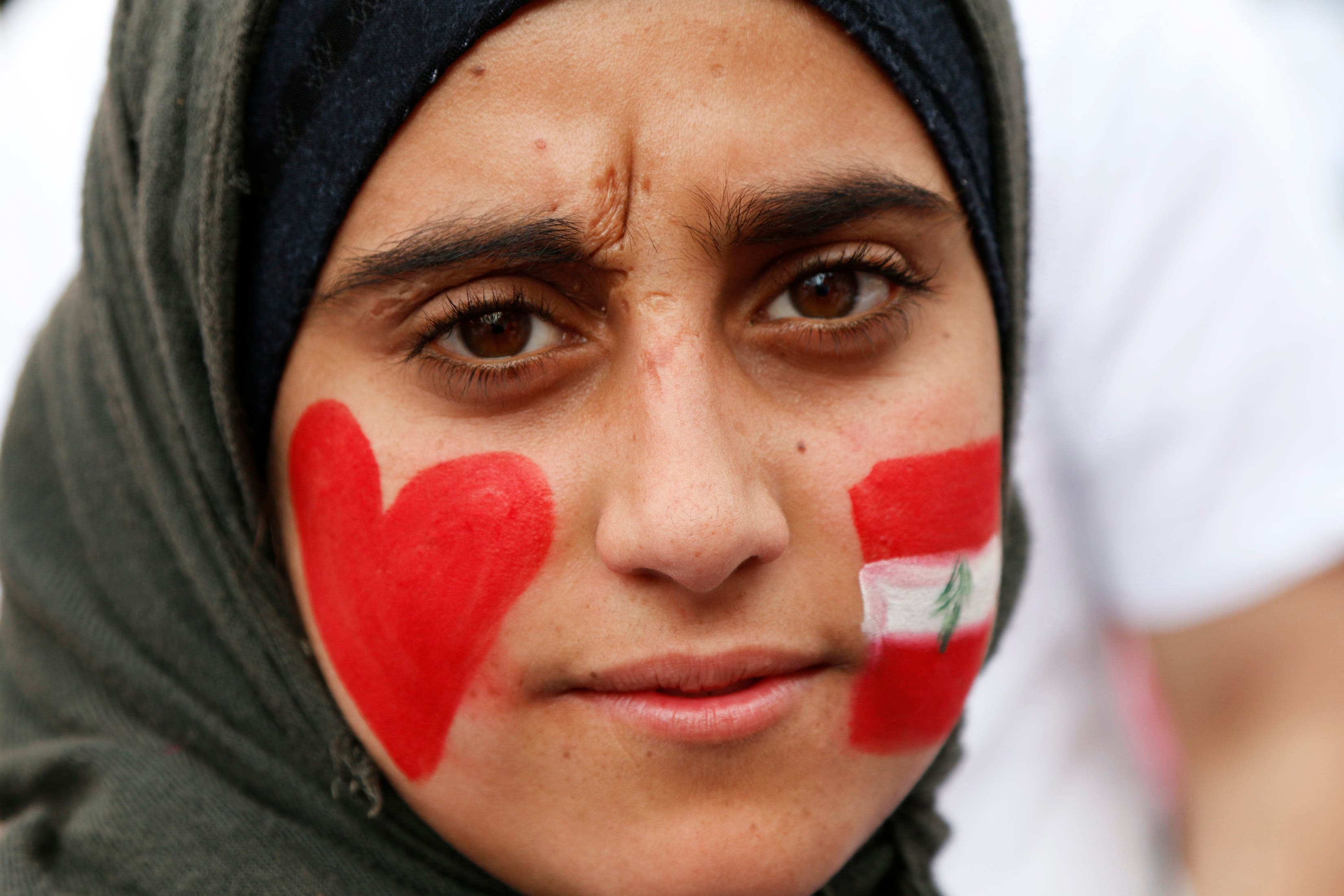 A youth, with her face painted in the colours of Lebanon's national flag and a heart in front of Beirut's national museum April 13, 2014. (Reuters)