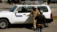 Ukraine rebel city says holding international observers