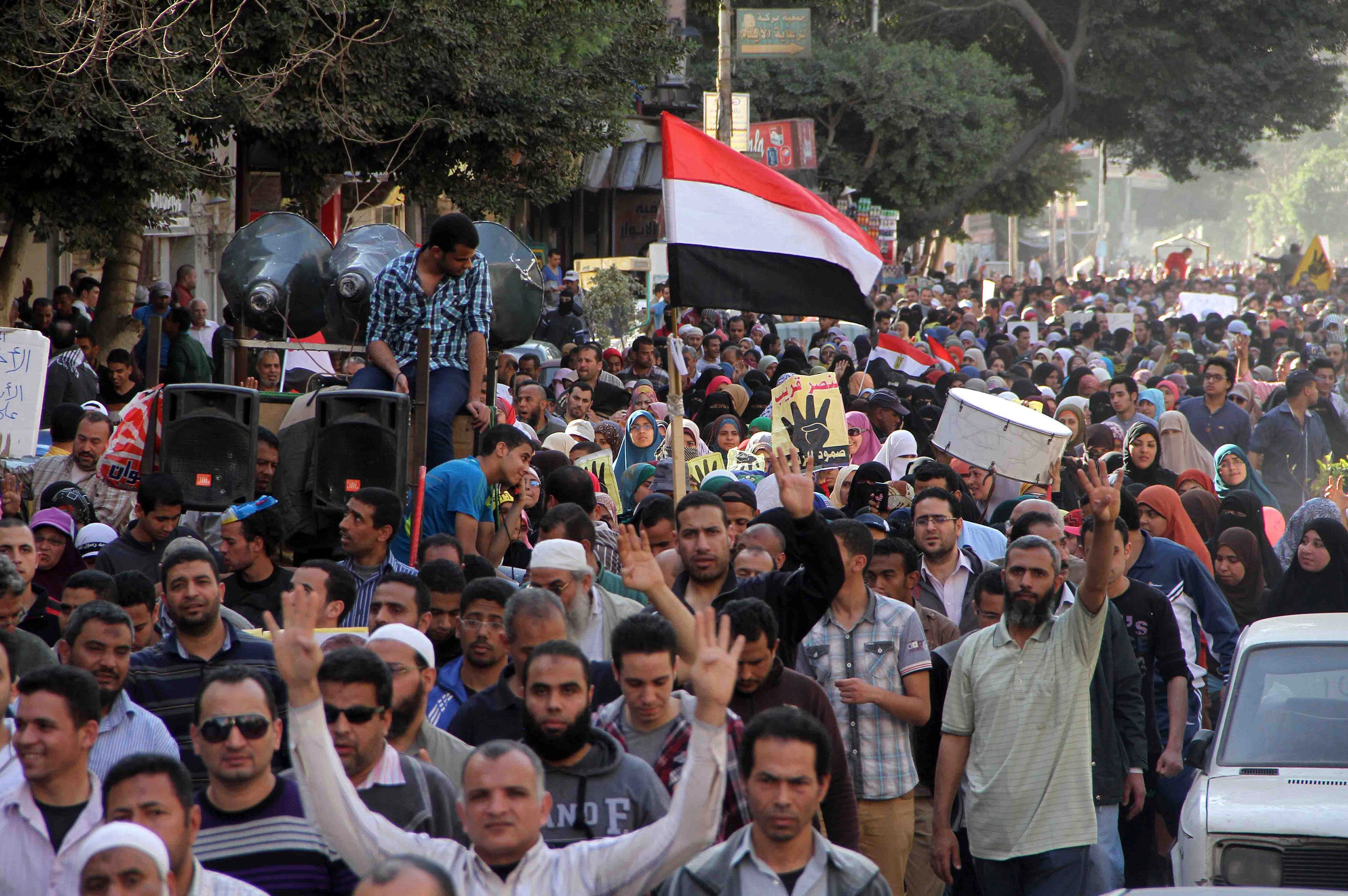 Pro -Mursi supporters walk during a demonstration in Ain Shams area east of Cairo, March 28, 2014. (Reuters)