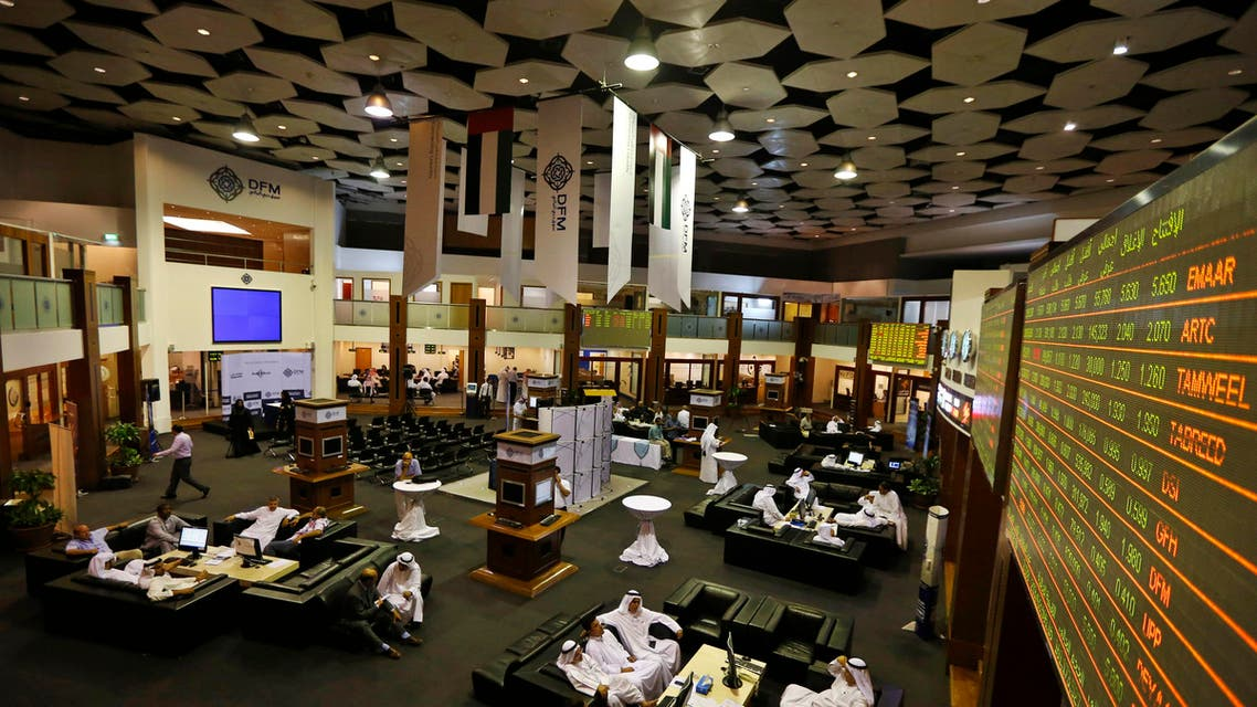 Screens displaying stock information are seen as investors look on at the Dubai Financial Market, June 17, 2013. (Reuters)