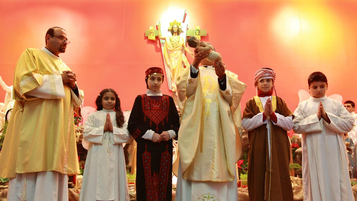 Christian children from Jordan, Syria, Iraq and Egypt, participate during a Christmas Mass in Amman reut