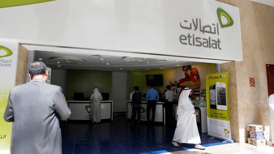A customer walks out of an Etisalat shop at the Dubai World Trade Centre in Dubai. Reuters