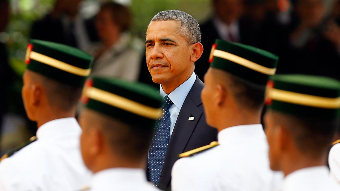 U.S. President Barack Obama inspects an honour guard during a state welcoming ceremony outside the Parliament house in Kuala Lumpur April 26, 2014 reuters