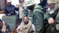 Court to name Qaddafi son lawyer in trial by video link