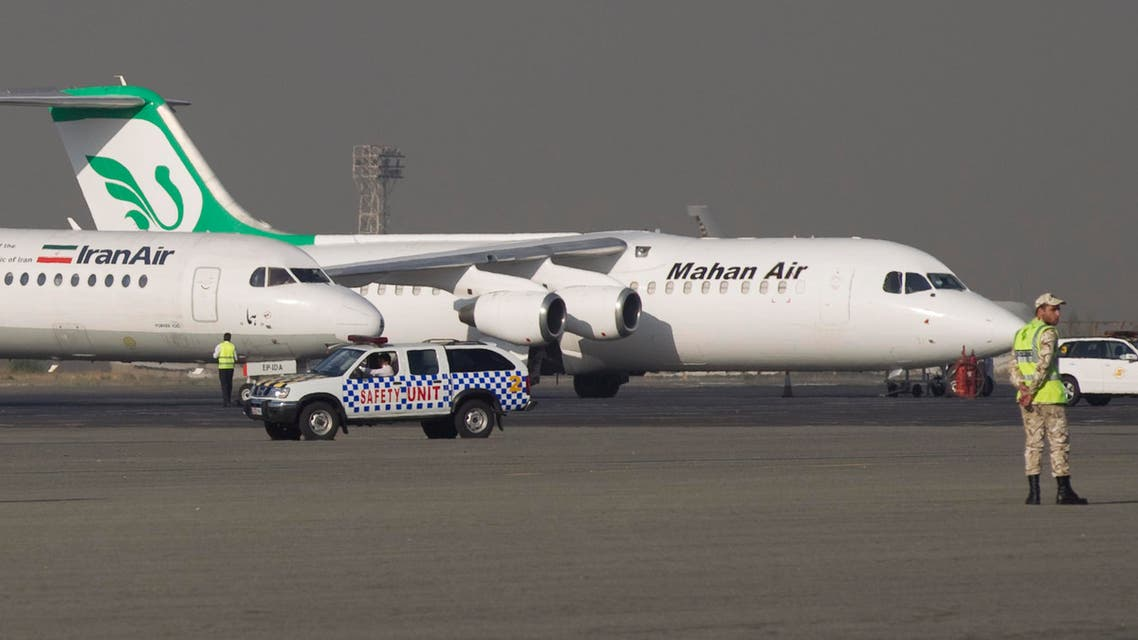 A jet of the Iranian airline Mahan Air is seen in background at Tehran's Mehrabad airport. (File photo Reuters)