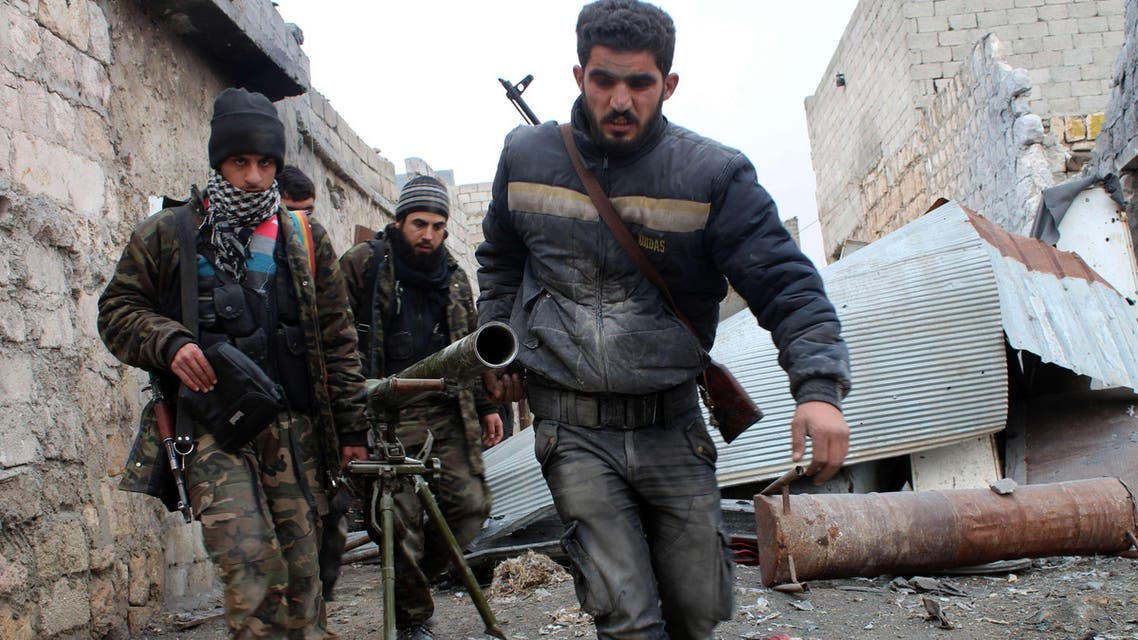 A file picture shows opposition fighters carrying a rocket launcher during clashes against Syrian government forces. (AFP)