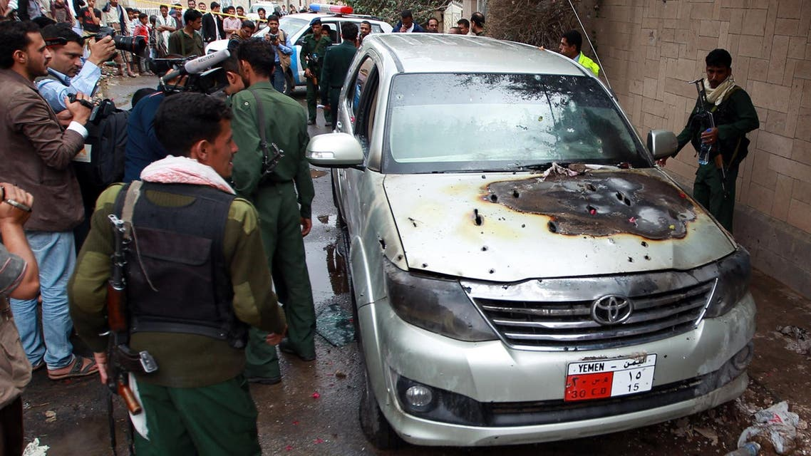 Yemeni soldiers and reporters inspect a bullet riddled car which was used by staff from the French embassy after it was attacked by gunmen on May 5, 2014 in Sanaa's diplomatic district of Hada. (AFP)