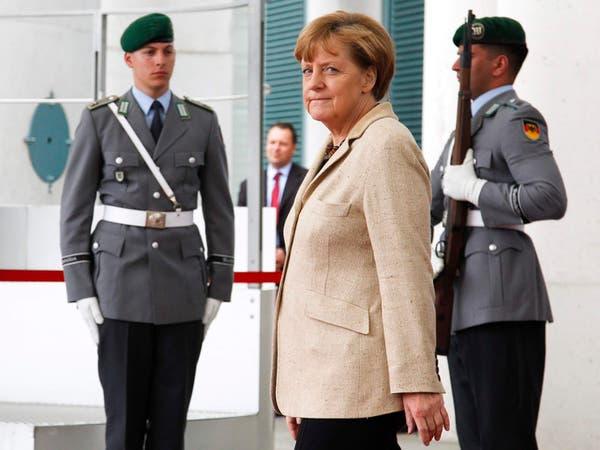 ميركل تأسف لعزم بوتين حضور عرض عسكري في القرم