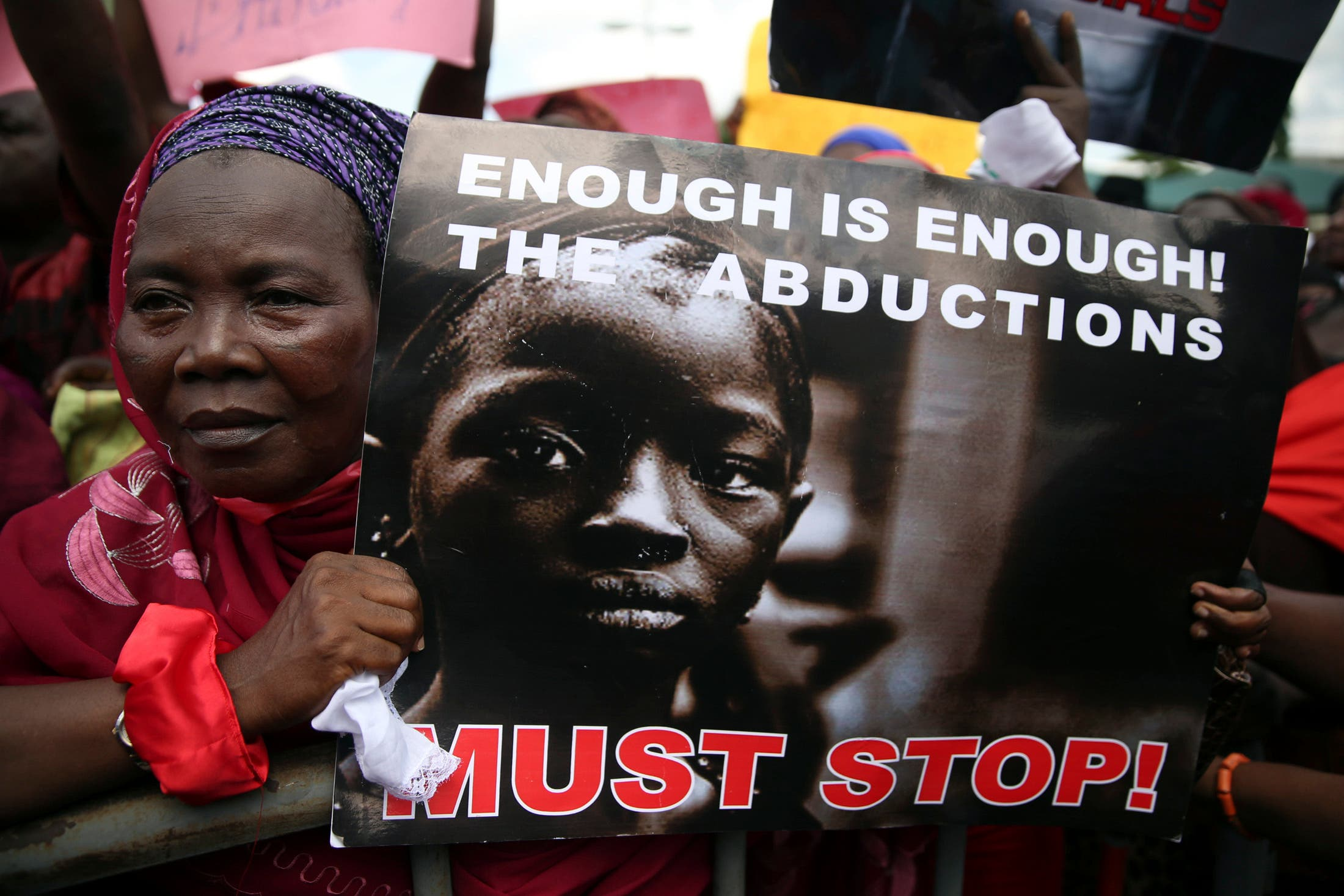 A woman holds a sign during a protest demanding the release of abducted secondary school girls from the remote village of Chibok, in Lagos May 5, 2014. (AFP)