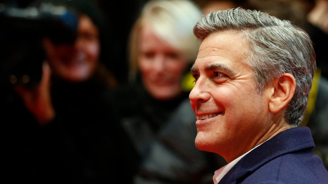 George Clooney smiles as he arrives on the red carpet for a screening of the movie 'The Monuments Men' at the 64th Berlinale International Film Festival in Berlin February 8, 2014. reuters