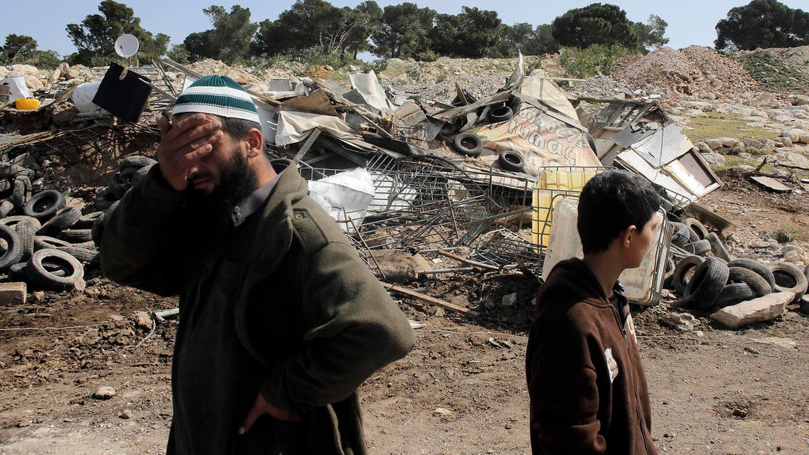 A Palestinian man reacts after his shanty, which Israel said was built illegally, was demolished by Israel's civil administration at a Bedouin encampment near Jerusalem April 3, 2014.  (Reuters)