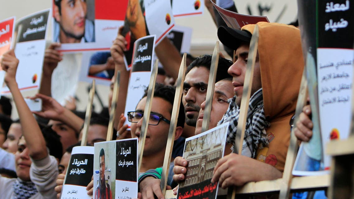 Members of the April 6 movement shout slogans with activists against the government as they protest against the detention of several members of their movement in Cairo, April 6, 2014. (Reuters)