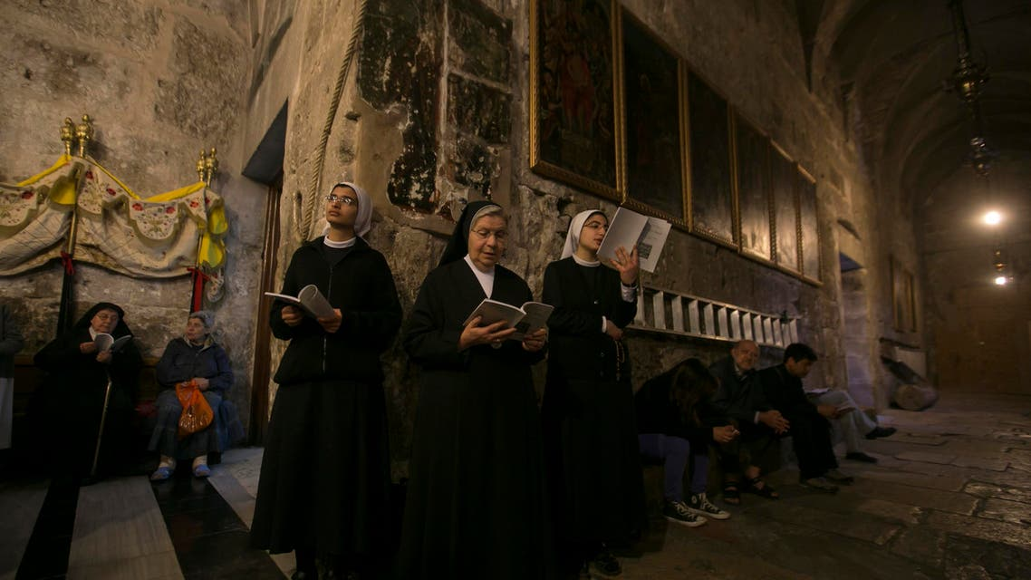 Nuns pray during the Catholic Washing of the Feet ceremony inside the Church of the Holy Sepulchre in Jerusalem's Old City April 17, 2014. (Reuters)