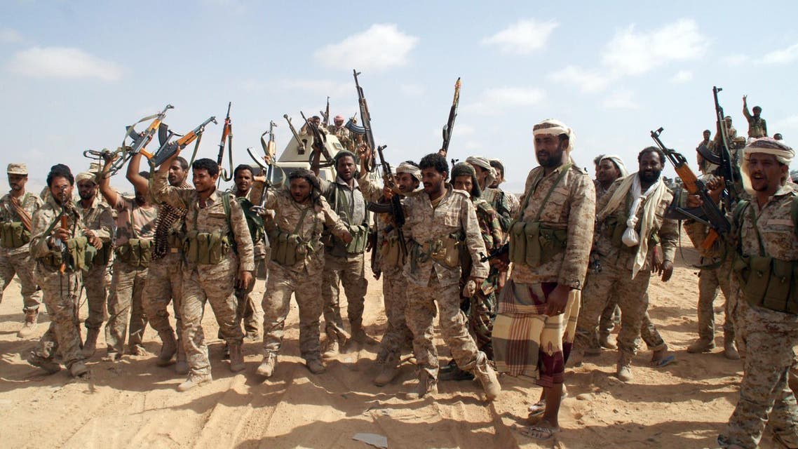 Yemeni soldiers brandish their weapons as they take part in an offensive against extremists in the southern province of Shabwa, on May 7, 2014. (AFP)