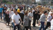 Civilians start returning to battered Homs
