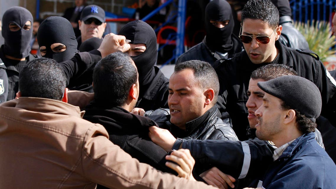 Police detain supporters of the National League for the Protection of the Revolution (LPR) during a protest demanding the release of LPR leader Imed Dghij in Tunis February 28, 2014. (Reuters)