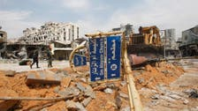 Syrians stream back into devastated Homs