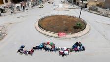 أمام القناص.. ناشطون يرسمون كلمة حمص بأجسادهم