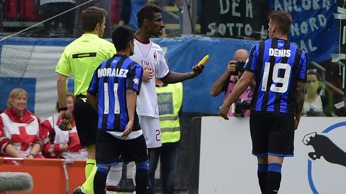 AC Milan's French defender Kevin Constant (C) shows a banana thrown on the pitch by football fans during the Italian Serie A football match Atalanta vs AC Milan on May 11, 2014. (AFP)