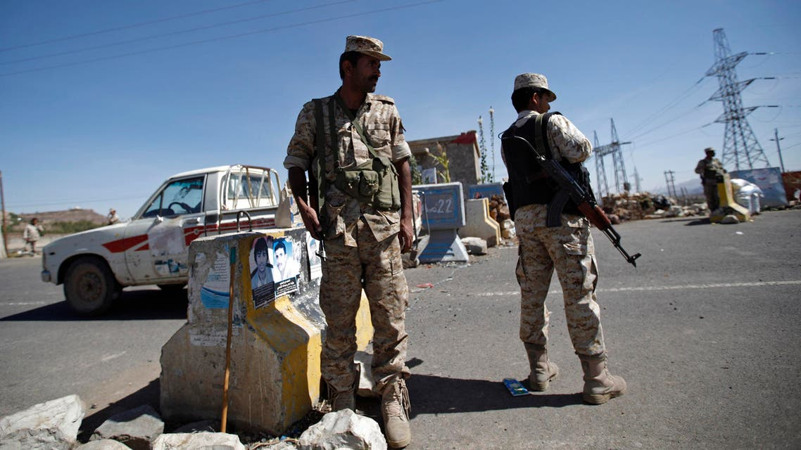 Army soldiers man a checkpoint outside Amran city, the capital of Amran province, north of Sanaa reuters