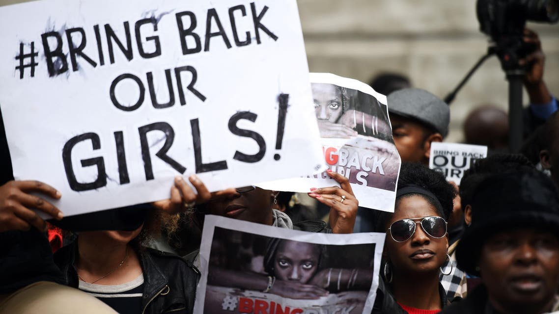Protestors hold placards as they demonstrate outside Nigeria House in central London on May 9, 2014, to demand the return of more than 200 Nigerian schoolgirls abducted by the Boko Haram Islamist group. AFP