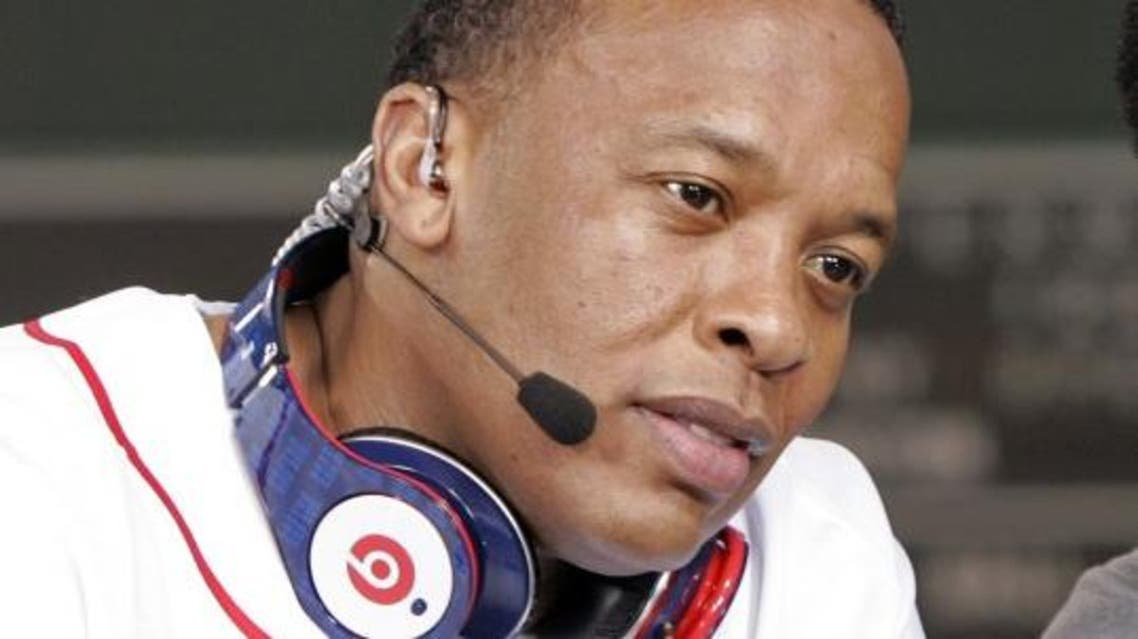 The maker of the iPhone and iPad is reportedly preparing a $3.2 billion bid for Beats, which was cofounded by Dr. Dre. (File photo: Reuters)