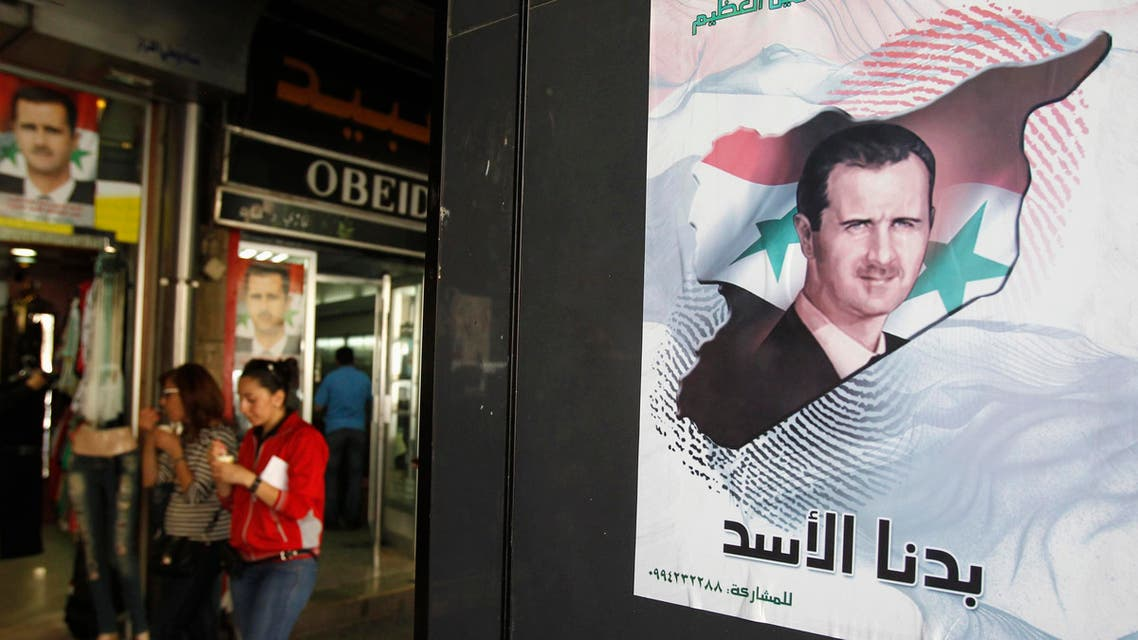 A poster of Syrian President Bashar al-Assad is seen at a street in Damascus April 28, 2014. Reuters